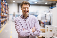 Portrait of smiling businessman in factory - DIGF03404