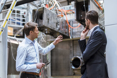 Two businessmen discussing in factory - DIGF03442