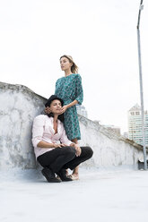 Portrait of a young affectionate couple on a rooftop - SBOF01372