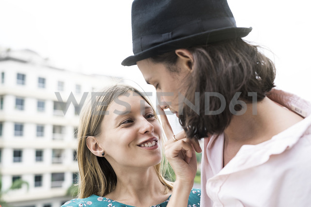 Young affectionate couple standing on rooftop - SBOF01375