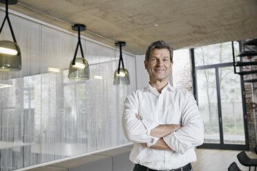 Portrait of confident businessman in modern office - PDF01453
