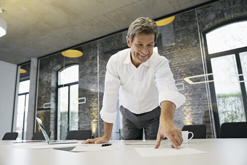 Businessman working with documents on desk in modern office - PDF01510