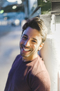 Portrait of laughing young man in the evening - AFVF00163