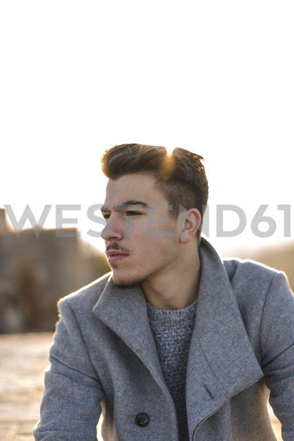 Portrait of serious young man at sunset - AFVF00166