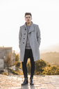 Portrait of fashionable young man wearing grey coat - AFVF00169