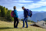 Italy, South Tyrol, Ueberetsch-Unterland, Hikers at Vigiljoch - LBF01778