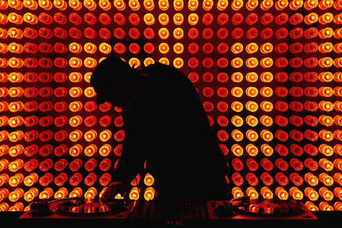 A DJ scratching a record in a nightclub - FSIF02681