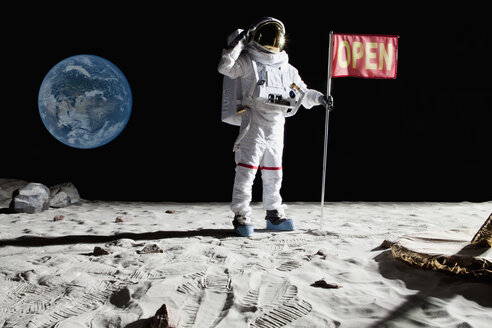 An astronaut on the moon saluting next to a flag with OPEN on it - FSIF02762