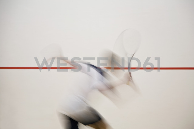 A man playing squash, blurred motion - FSIF02798