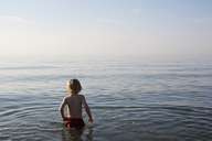 A young boy standing in the sea - FSIF02816
