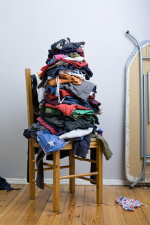 A big untidy stack of clean clothes waiting to be ironed - FSIF02863