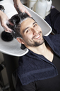 A man having his hair washed at a hair salon - FSIF02866