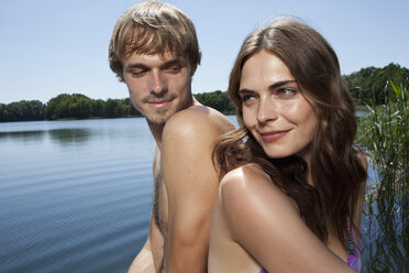 Couple back to back beside the lake - FSIF02893
