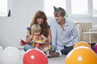 Two young parents with their daughter, celebrating her birthday - FSIF02962