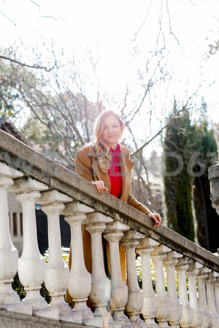 Portrait of smiling young woman in a public garden - AFVF00178