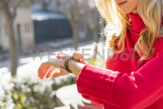 Close-up of woman using checking the time in a garden - AFVF00184