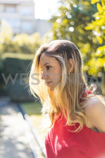 Portrait of attractive young woman in a garden - AFVF00187