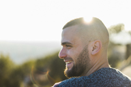 Profile of happy young man in backlight - AFVF00201