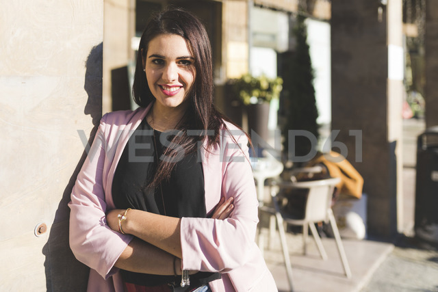 Portrait of smiling young woman in the city - WPEF00142