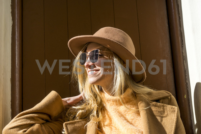 Portrait of fashionable young woman at entry door - AFVF00228
