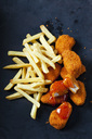 Chicken Nuggets with sweet chili sauce and French Fries on dark ground - CSF28940