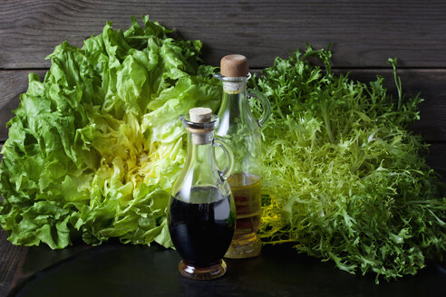 Endive and curled endive salad and vinegar and olive oil in bottles - CSF28967