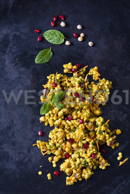 Couscous salad with chick peas and cranberries on dark ground - CSF28973