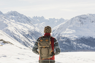 Switzerland, Engadin, hiker in mountainscape looking at view - MRAF00263