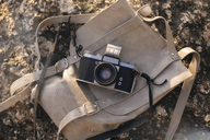 Analogue camera on backpack outdoors - KNTF01003