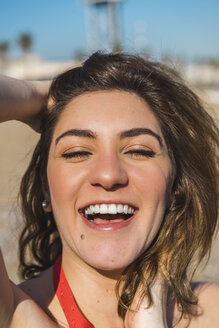 Portrait of laughing young woman on the beach - AFVF00277