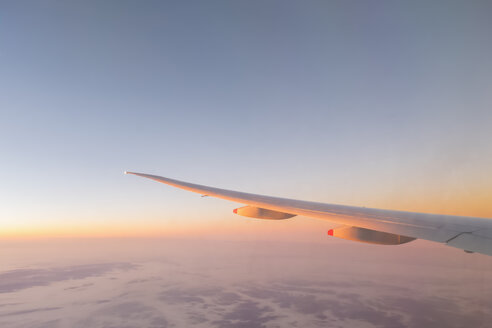 Europe, wing of an airplane with clouds at sunrise - FOF09842