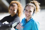 Portrait of two smiling sportive young women having a break - JSRF00017