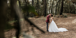 Bride and groom kissing in forest - DAPF00897
