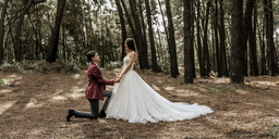 Man kneeling making a marriage proposal to happy bride in forest - DAPF00900