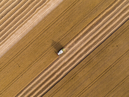 Serbia, Vojvodina. Combine harvester on a field of wheat, aerial view - NOF00011
