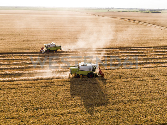Serbia, Vojvodina. Combine harvester on a field of wheat, aerial view - NOF00014