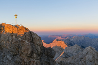 Austria, Germany, Bavaria, Zugspitze, summit cross in the evening light - FOF09850