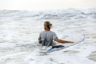 Indonesia, Bali, surfer and surfboard in the water - KNTF01012