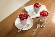 Chia pudding with rasberry topping on kitchen counter - JHAF00028