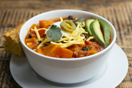 Vegan winter squash chili, served with cornbread. - HAWF00989