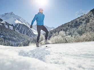 Austria, Tyrol, Luesens, Sellrain, cross-country skier in snow-covered landscape - CVF00155