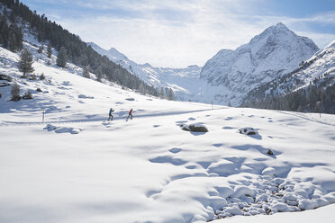 Austria, Tyrol, Luesens, Sellrain, two cross-country skiers in snow-covered landscape - CVF00158