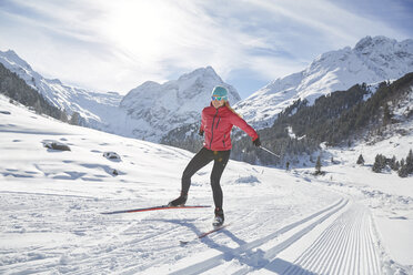 Austria, Tyrol, Luesens, Sellrain, cross-country skier in snow-covered landscape - CVF00161