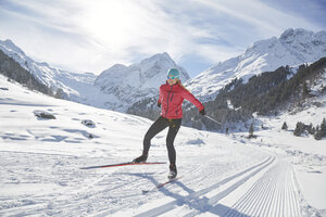 Austria, Tyrol, Luesens, Sellrain, cross-country skier in snow-covered landscape - CVF00161