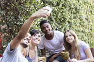 Happy friends having cocktails and taking a selfie outside - LFEF00083