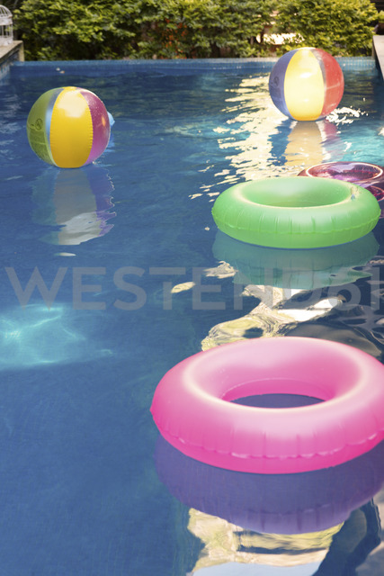 Pooltoys floating on water in swimming pool - LFEF00101