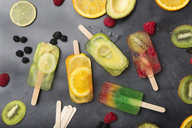 Various fruit popsicles and fruits on grey background - SKCF00339