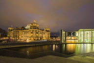 Germany, Berlin, Reichstag and Paul Loebe Government Building at Spree river in the evening - FOF09889