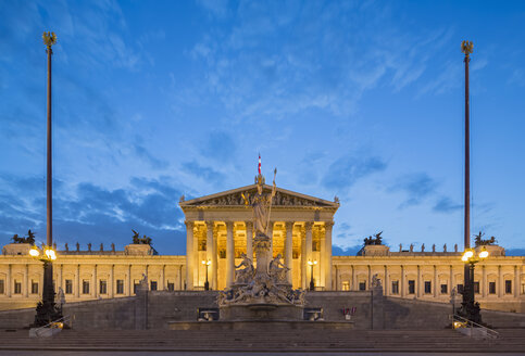 Austria, Vienna, view to parliament building with statue of goddess Pallas Athene in the foreground at blue hour - FOF09919