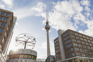Germany, Berlin, Urania world clock and Berlin TV tower at Alexanderplatz - GW05462